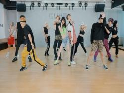 "Watch: Triple H Gets Funky And Sexy In ""Retro Future"" Choreography Video"
